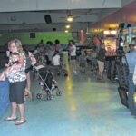 Students rewarded for reading with a roller skating trip