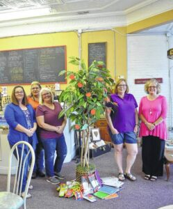 Planting a message of giving through a teacher tree