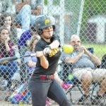 Lady Wildcats win in extra innings